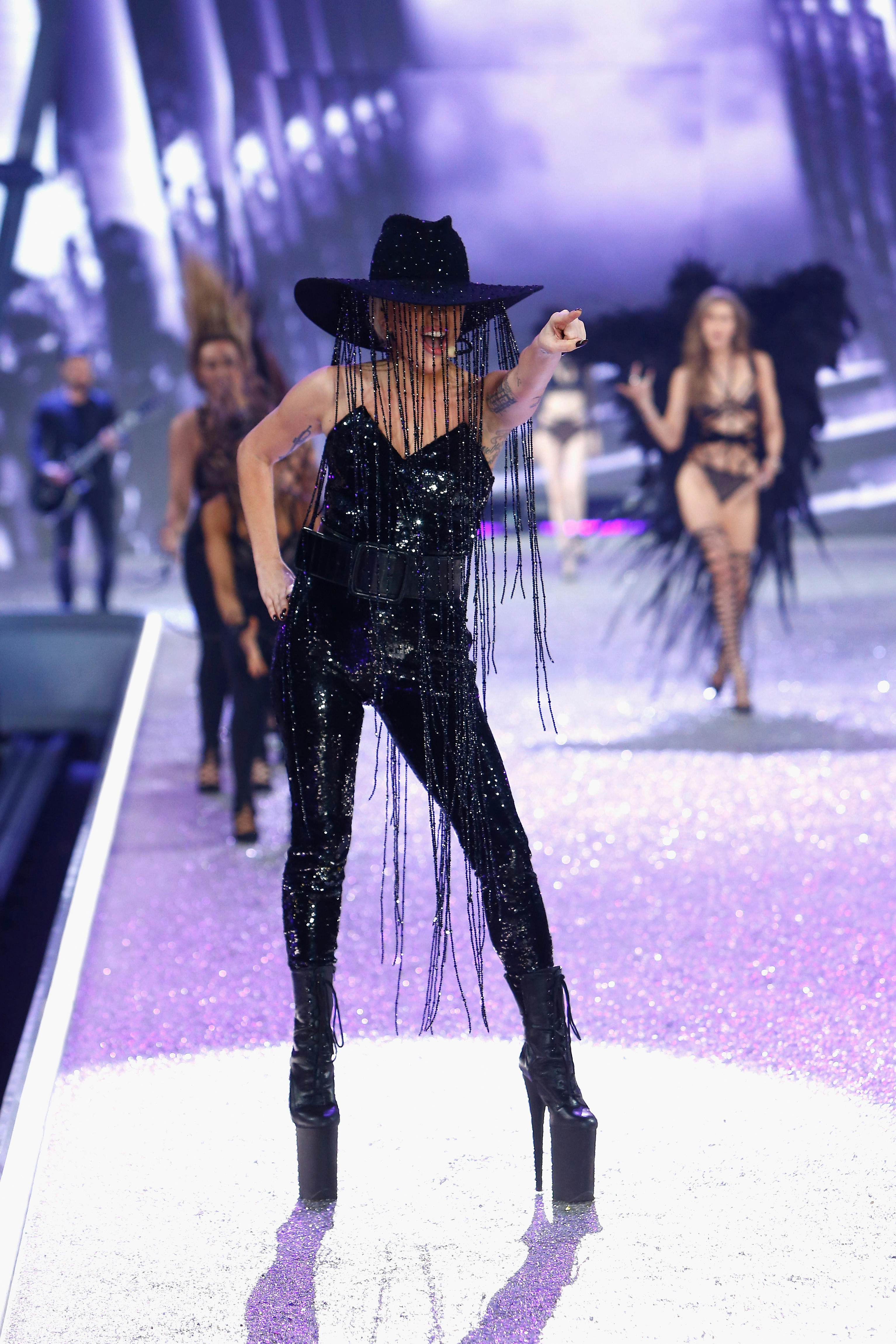 Lady Gaga wears a Gladys Tamez Millinery bespoke hat adorned with Swarovski crystals at VSFS