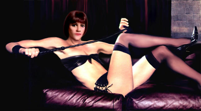 Ms Fraser in a leather bikini with a crop, lounging