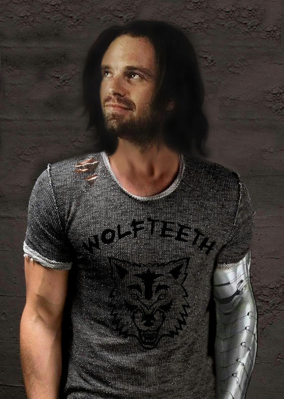 Bucky in a ripped gray t-shirt with wolfteeth name and logo of a wolf's head, looking up and smiling.