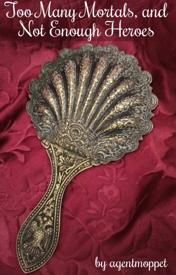 An old, fan-shaped, bronze handmirror rests face down on a lush, red, velvet blanket. The mirror has a double eagle engraved in the handle, and the blanket is embellished with flowers. Text: Too Many Mortals and Not Enough Heroes by agentmoppet
